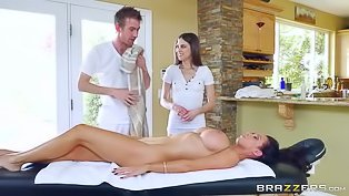 Strong masseur is fucking two brunettes