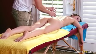 Dark-haired lady surrenders to masseur