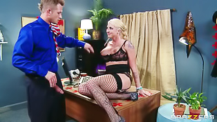 Fishnet-clad blonde fucked on a desk