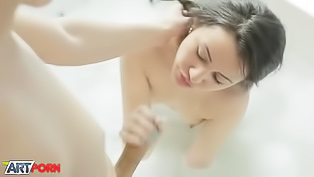 Lovers orgasm in soapy bath