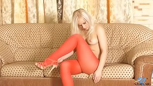 Horny blonde loves touching herself
