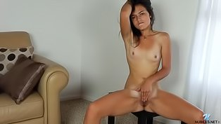 Brunette with small tits is masturbating