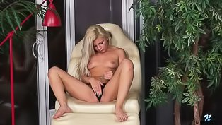 Cute blonde loves touching herself