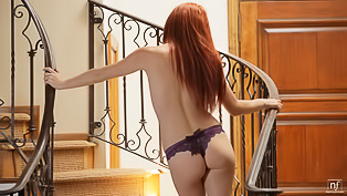 Ginger babe masturbates on stair-case