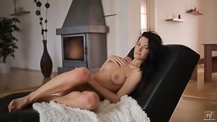 Sensual brunette is fingering her twat