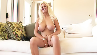 Busty slut is toying her vagina