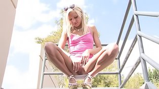 Horny blonde is playing with toys
