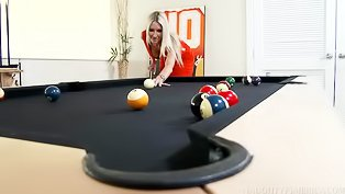 Blonde loves playing billiards so much