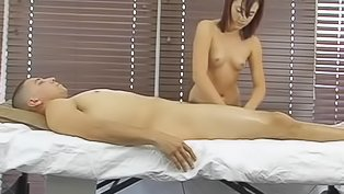 Masseuse is jerking her client's cock