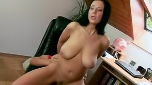 Big-tittied brunette is riding long cock