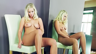 Blonde lady next to the mirror