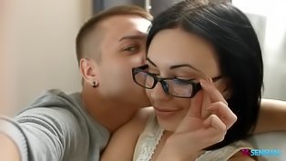 Brunette in black glasses gets fucked