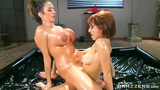 Oiled ladies are enjoying lesbian sex