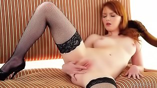 Redhead queen is pleasing herself