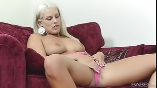 Blonde in pink is touching herself