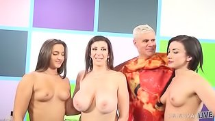 Three busty babes share a cock