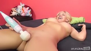 Blonde is playing with vibrator