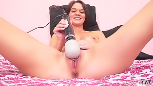 Sexy brunette with the black vibrator